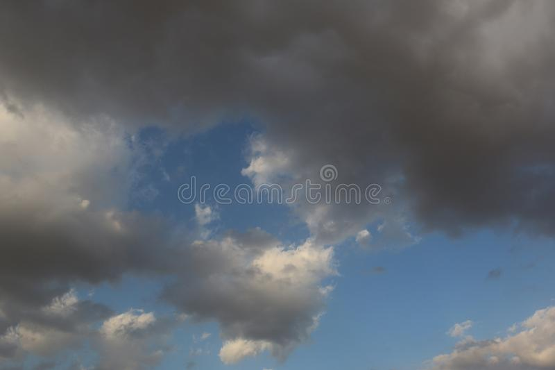 Beautiful Blue Sky Background With Dramatic Fluffy White Clouds And Sun Beam. Over Dubai, United Arab Emirates royalty free stock photos