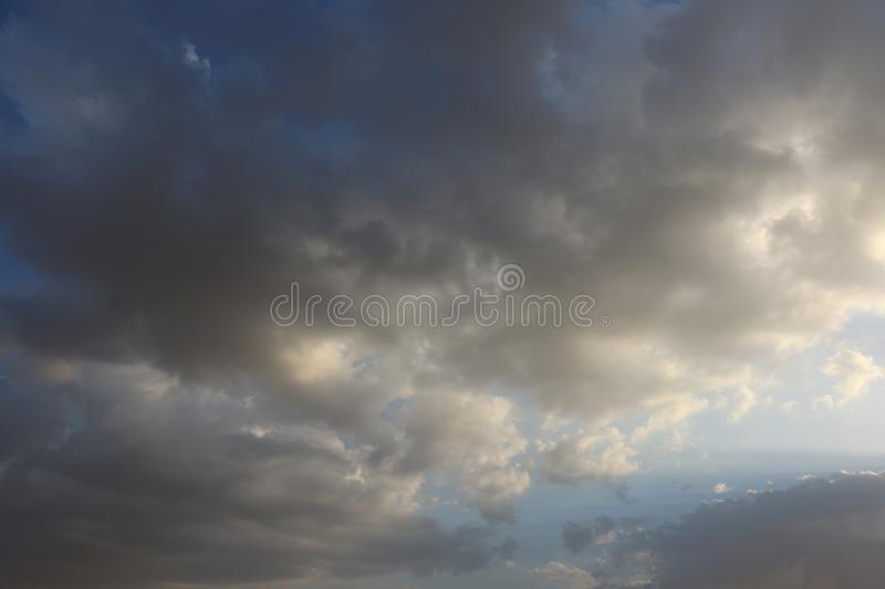 Beautiful Blue Sky Background With Dramatic Fluffy White Clouds And Sun Beam. Over Dubai, United Arab Emirates royalty free stock photography