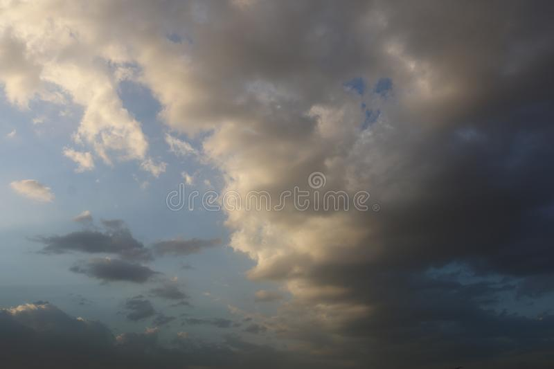 Beautiful Blue Sky Background With Dramatic Fluffy White Clouds And Sun Beam. Over Dubai, United Arab Emirates royalty free stock photo
