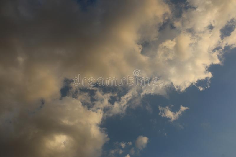 Beautiful Blue Sky Background With Dramatic Fluffy White Clouds And Sun Beam. Over Dubai, United Arab Emirates stock photos
