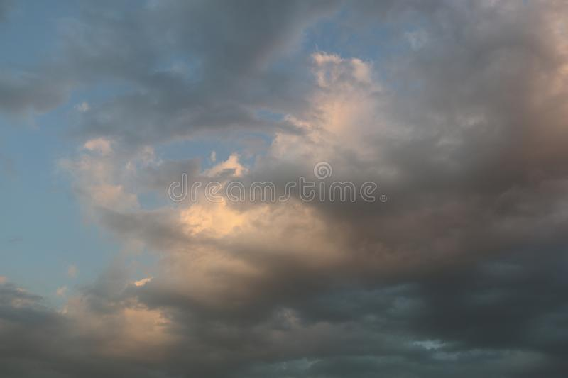 Beautiful Blue Sky Background With Dramatic Fluffy White Clouds And Sun Beam. Over Dubai, United Arab Emirates stock images