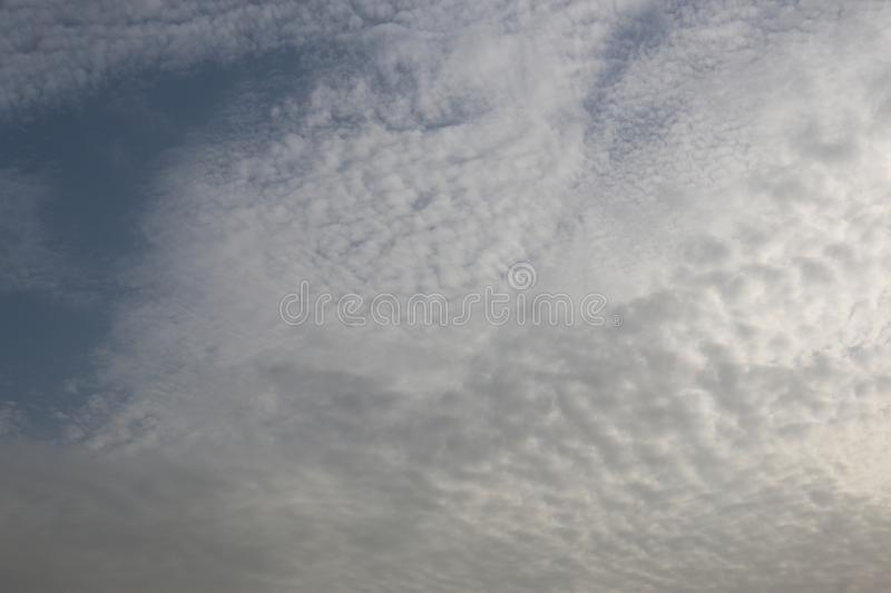 Beautiful Blue Sky Background With Dramatic Fluffy White Clouds And Sun Beam. Over Dubai, United Arab Emirates stock photo