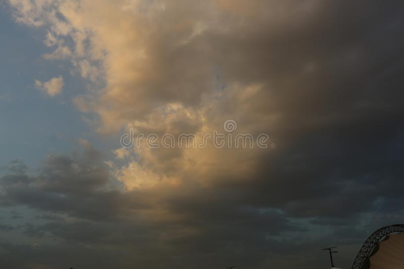 Beautiful Blue Sky Background With Dramatic Fluffy White Clouds And Sun Beam. Over Dubai, United Arab Emirates royalty free stock images