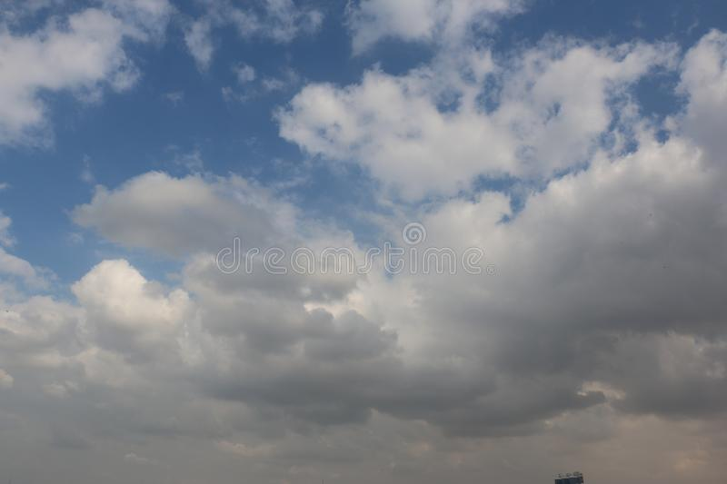 Beautiful Blue Sky Background With Dramatic Fluffy White Clouds And Sun Beam. Over Dubai, United Arab Emirates royalty free stock image