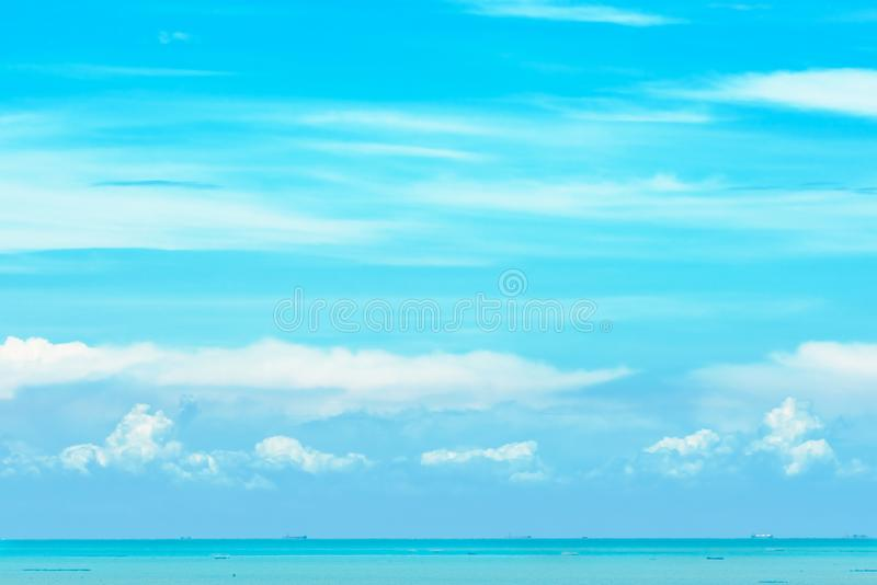 Beautiful blue sky blue sea water and white clouds on sunny day. Cloudscape. Transport ship in the sea. Soft color of pastel blue. Sky and fluffy clouds. Peace stock image