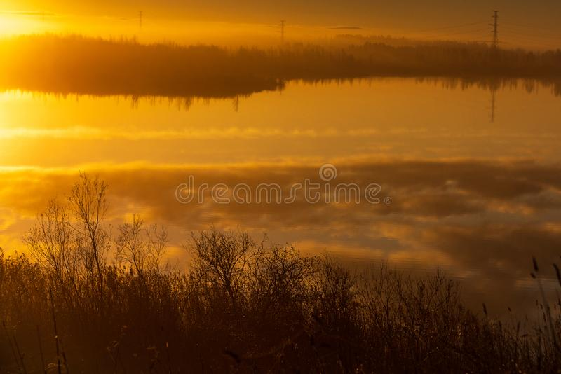 Beautiful blue sky and cloud reflection in the water. Beautiful autumn morning in the countryside near the lake, fog in the distance, beautiful blue sky and royalty free stock images