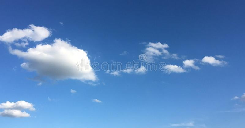 Beautiful blue sky with clouds background.Sky with clouds weather nature cloud blue.Blue sky with clouds and sun. Beautiful blue sky with clouds background.Sky royalty free stock images