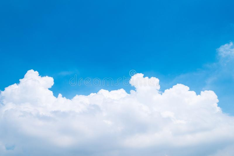 The beautiful blue sky with clouds. Background stock photo