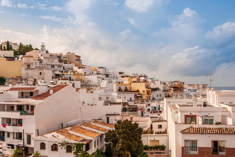 Beautiful blue sky with clouds over the Costa Tropical town of La Herradura, Granada, Spain. On a sunny, Summer morning stock photos