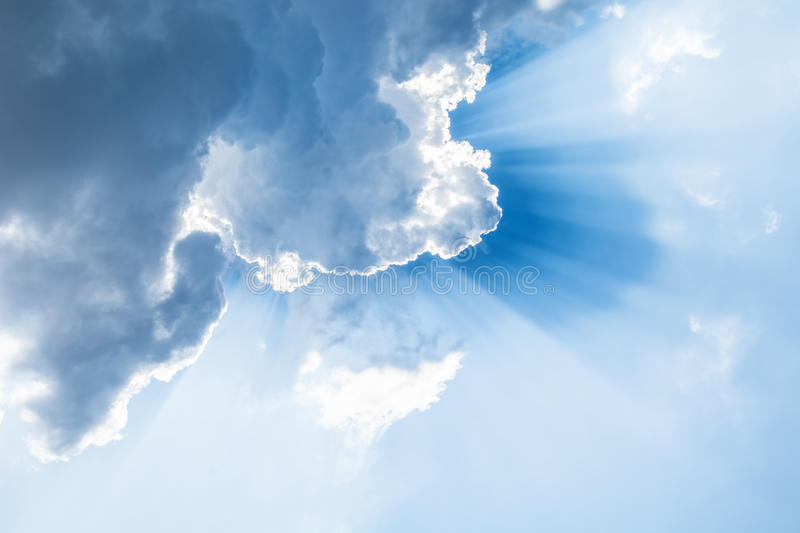 Beautiful blue sky with clouds and rays of sun. Abstract background royalty free stock images