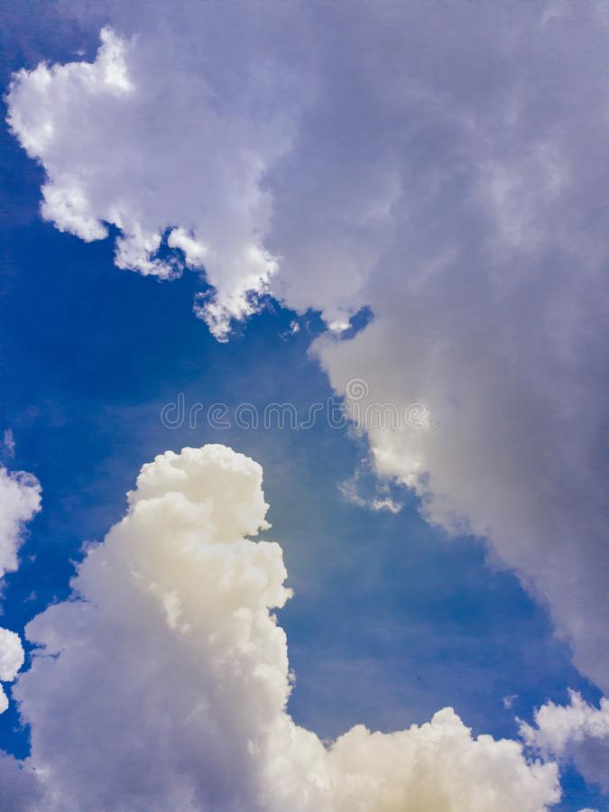 Beautiful blue sky with clouds and sun light background.Sky clouds.Sky with clouds weather nature cloud blue royalty free stock images