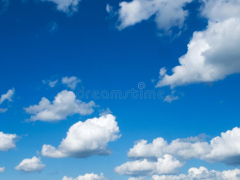 Beautiful blue sky with cumulus humilis clouds on a sunny day. Beautiful blue sky with cumulus humilis clouds with flat bottoms and fluffy tops on a mostly sunny royalty free stock image