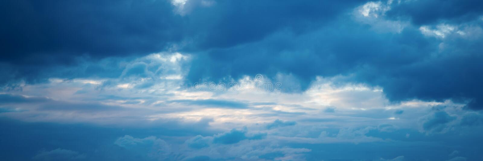 Beautiful Blue Sky with Dramatic Clouds. Nature Spectacles panorama. Beautiful Blue Sky with Dramatic Clouds. A Nature Spectacles banner backgrounds, color royalty free stock image