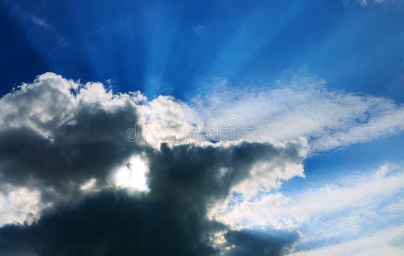 Sunshine on a gray sky and Heart shaped cloud. stock photos