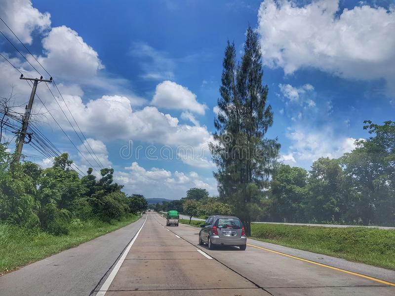 On The road from Nongkhai to Khonkaen, Thailand. Beautiful blue sky and green scenery along the side of the road from Nongkhai, Udon and Khonkaen, Thailand stock image