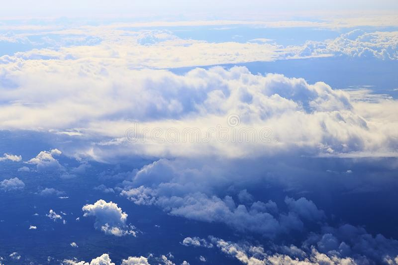 Beautiful blue sky high view on white clouds from an airplane window. On the way to London stock image