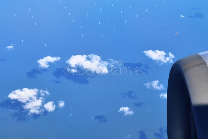 Beautiful blue sky high view on white clouds from an airplane window. On the way to London stock photos