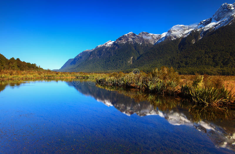 Beautiful blue sky at Mirror Lakes. Mirror Lakes, South Island, New Zealand stock images