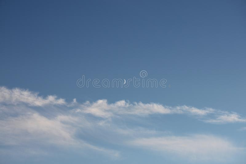 Beautiful Blue sky with Moon and fluffy White cloud stock photos