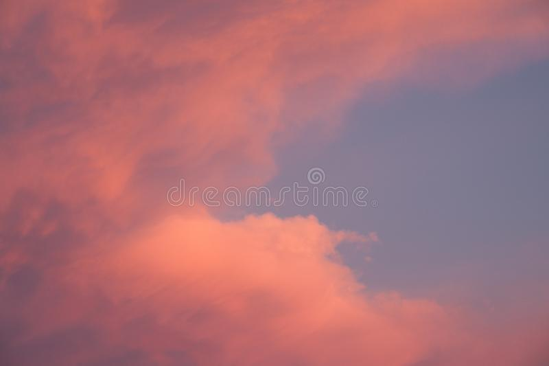 Beautiful blue sky in pink sunset clouds royalty free stock images
