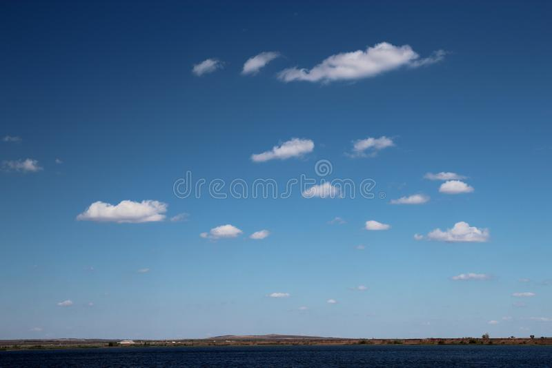 Beautiful blue sky with rare white clouds on a Sunny day stock image