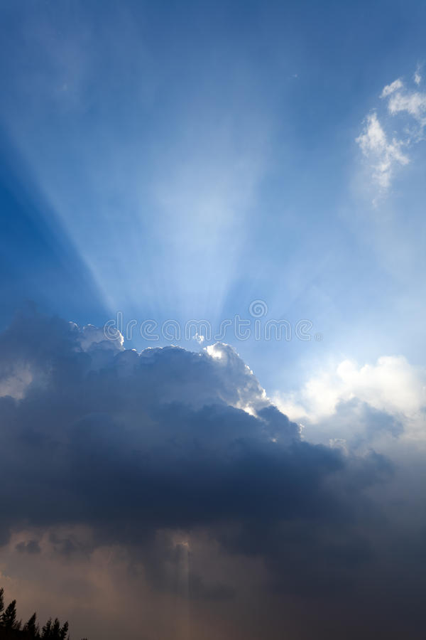 Beautiful blue sky,sun rays and clouds royalty free stock photos