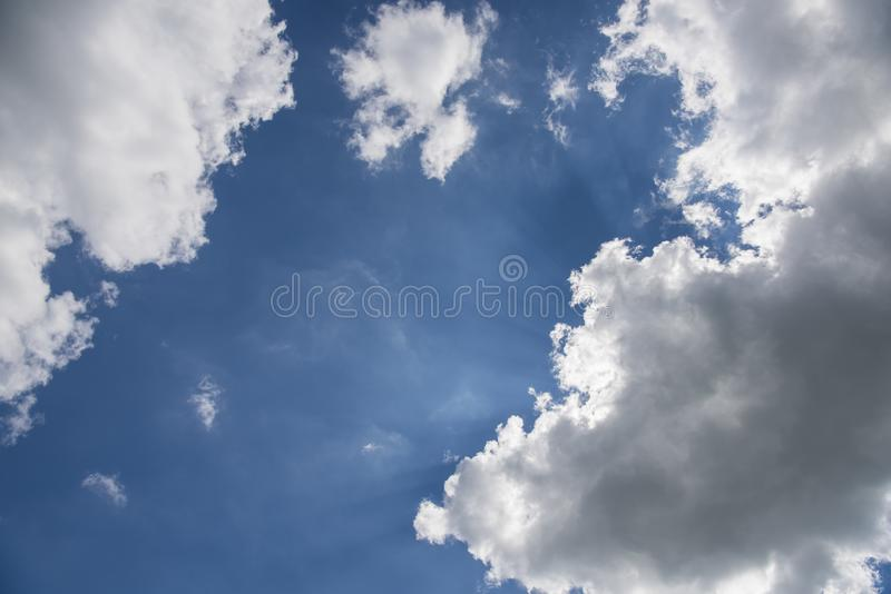 Beautiful blue sky with sunbeams and clouds. Sun rays.  royalty free stock photo