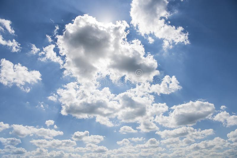 Beautiful blue sky with sunbeams and clouds. Sun rays.  stock images