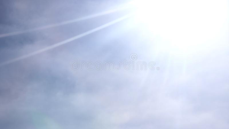 Beautiful blue sky with sunbeams and clouds. royalty free stock images