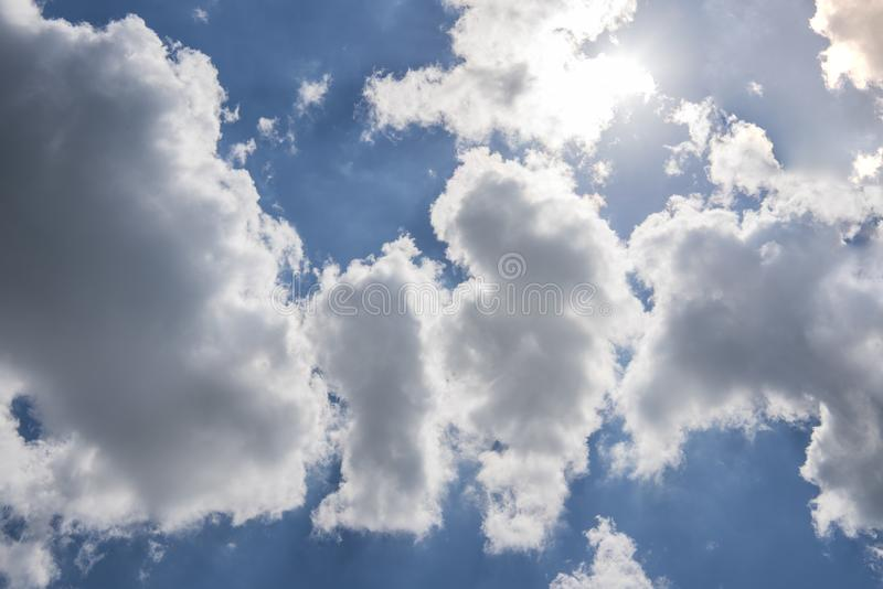 Beautiful blue sky with sunbeams and clouds. Sun rays stock images