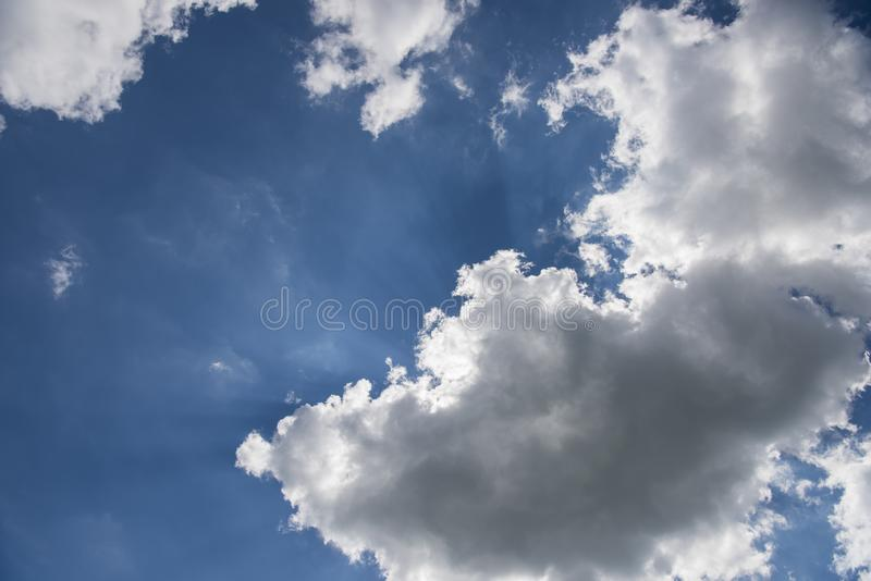 Beautiful blue sky with sunbeams and clouds. Sun rays.  stock image