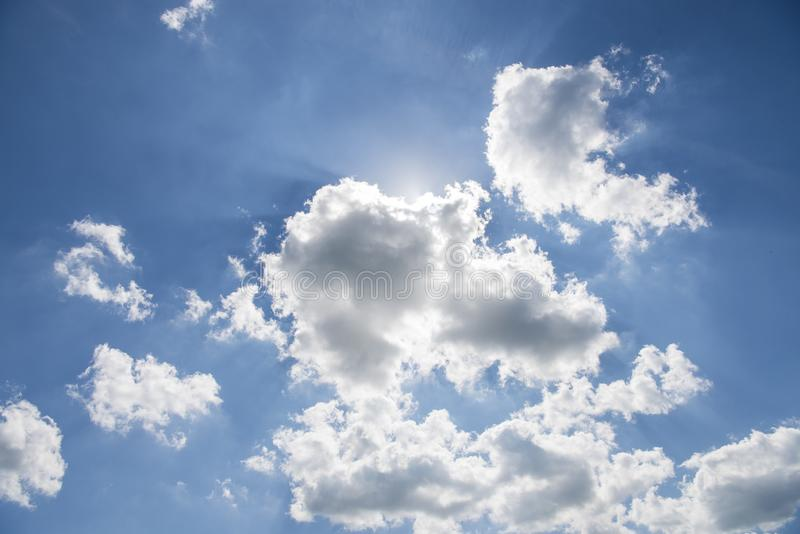 Beautiful blue sky with sunbeams and clouds. Sun rays.  royalty free stock photography