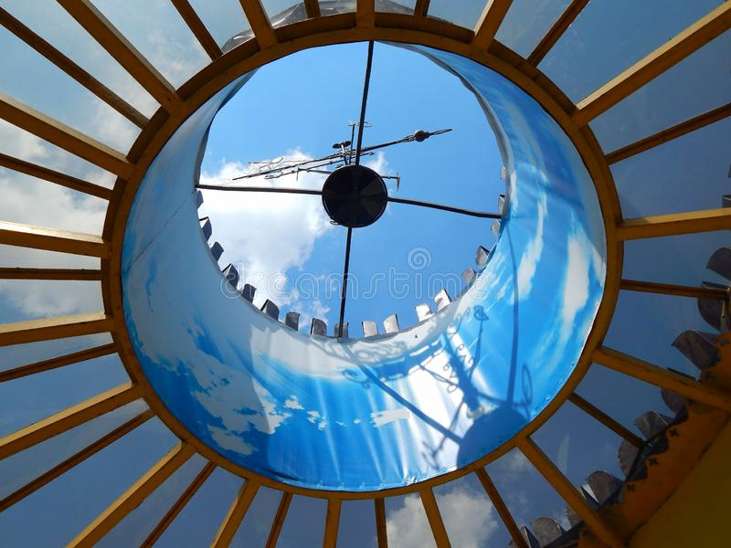 Beautiful blue sky view from the bottom up through the roof.  stock images