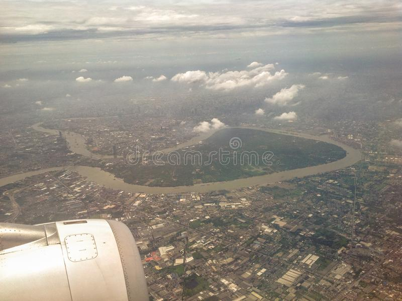 The beautiful blue sky, white cloud, land and house can be visible from the plane. In Thailand royalty free stock images
