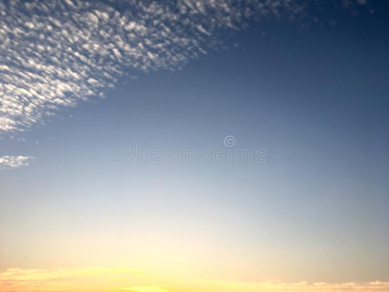 Beautiful blue sky and white cloud on sunset in the twilight time. Color shade of nature background royalty free stock photo