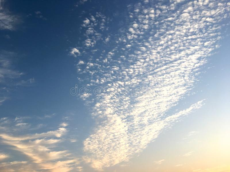 Beautiful blue sky and white cloud on sunset in the twilight time. Color shade of nature background stock photos