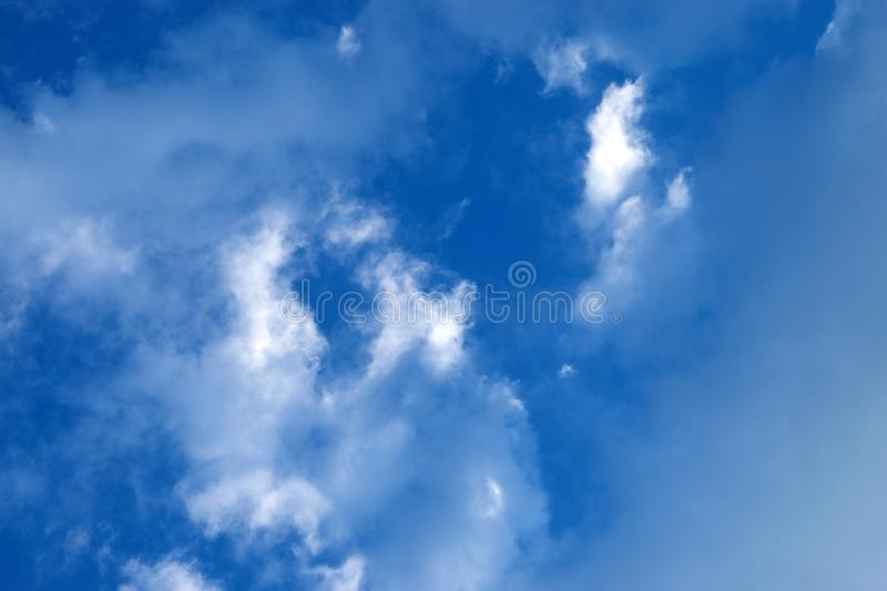 Beautiful blue sky with white clouds. Natural background of the sky with clouds royalty free stock photo