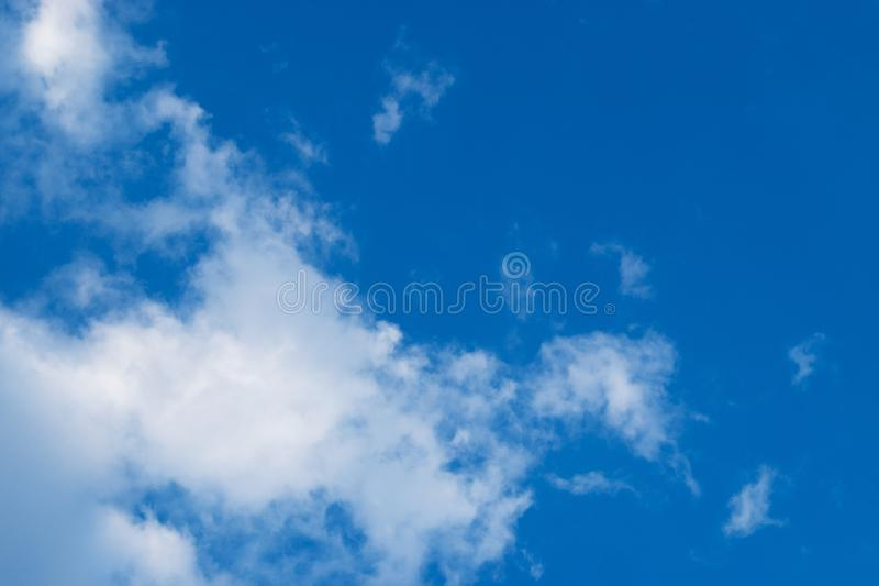 Beautiful blue sky with white clouds. Natural  background of the sky with clouds royalty free stock photography