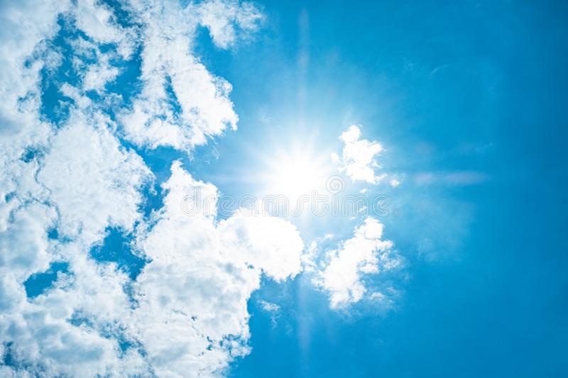 Beautiful blue sky with white clouds and sunlight. Background abstract panorama stock photo