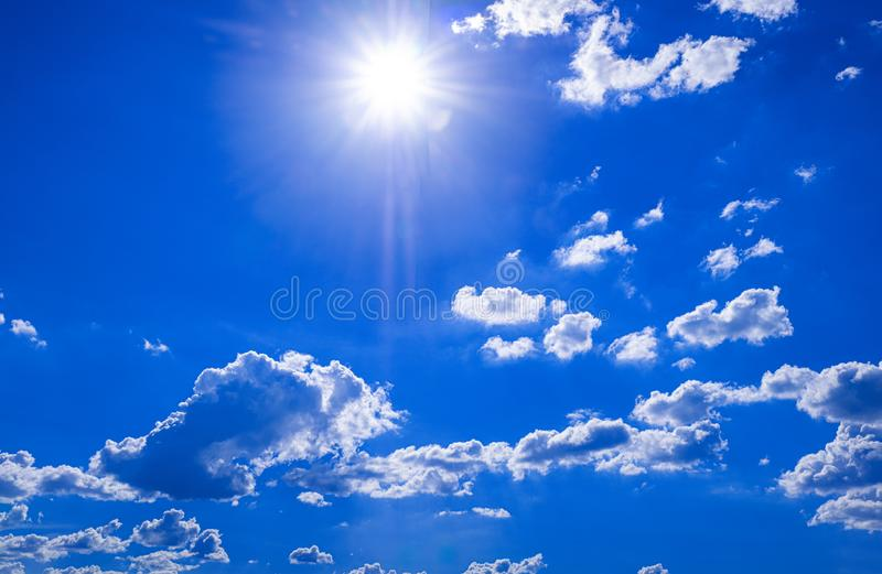 Beautiful blue sky with white clouds and sunlight. Background abstract panorama royalty free stock photo