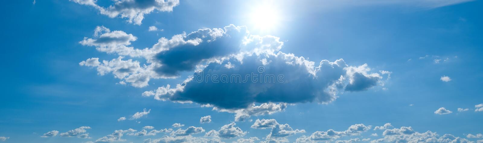 Beautiful blue sky with white clouds and sunlight. Background abstract panorama stock photos
