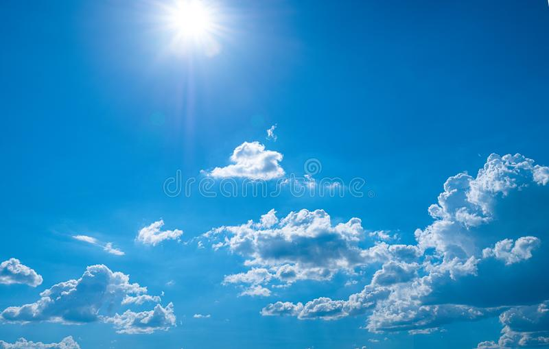 Beautiful blue sky with white clouds and sunlight. Background abstract panorama royalty free stock photography