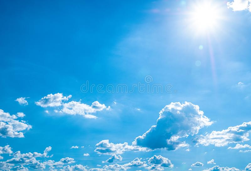 Beautiful blue sky with white clouds and sunlight. Background abstract panorama royalty free stock image