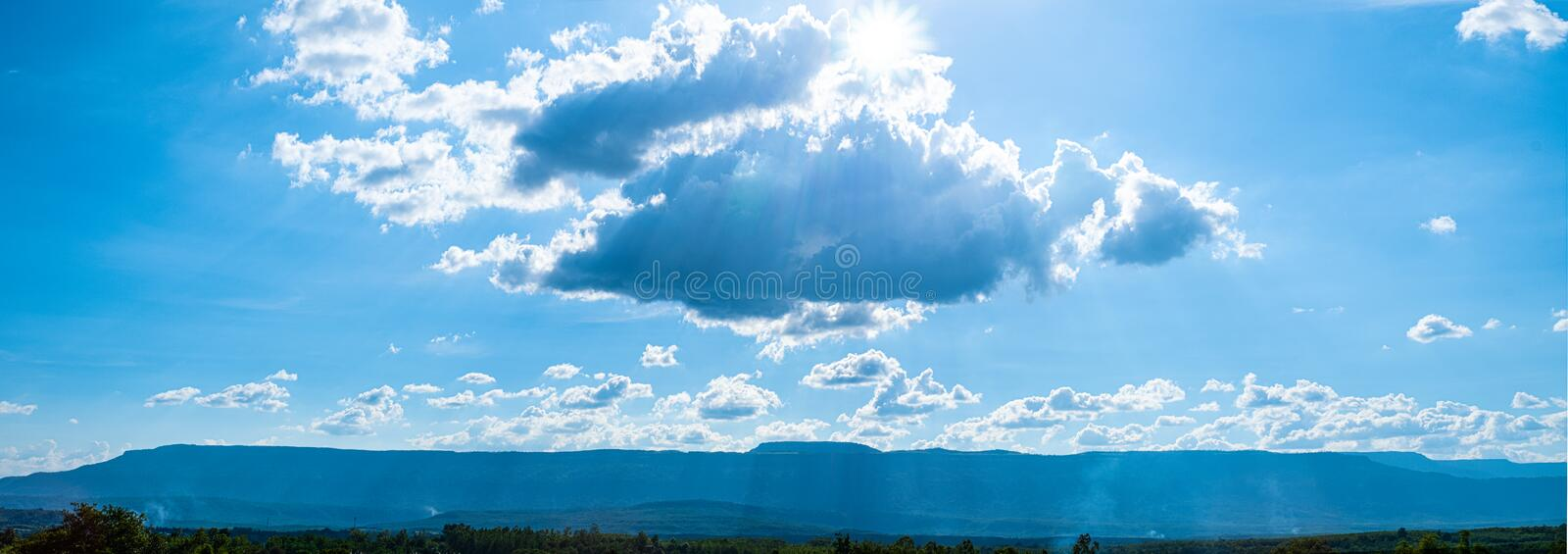 Beautiful blue sky with white clouds and sunlight. Background abstract panorama stock images