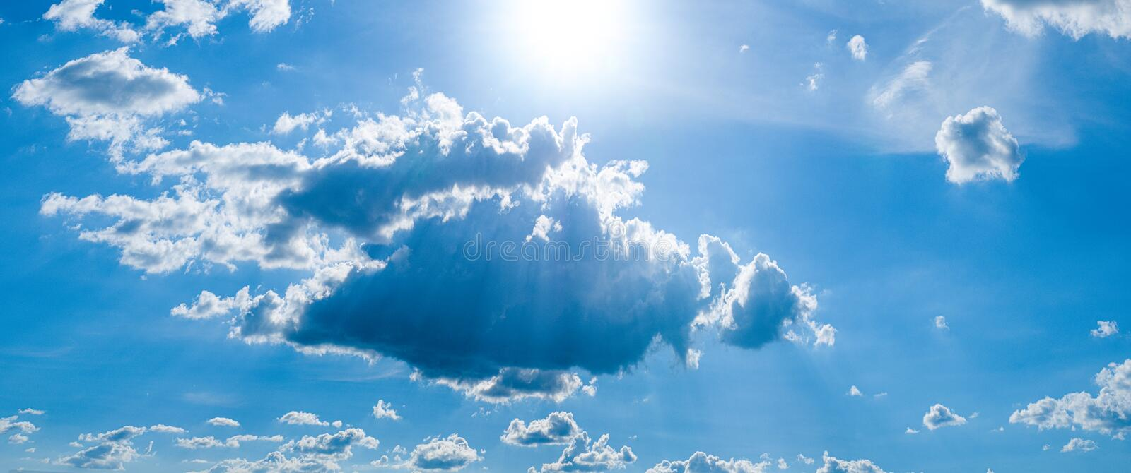Beautiful blue sky with white clouds and sunlight. Background abstract panorama royalty free stock images
