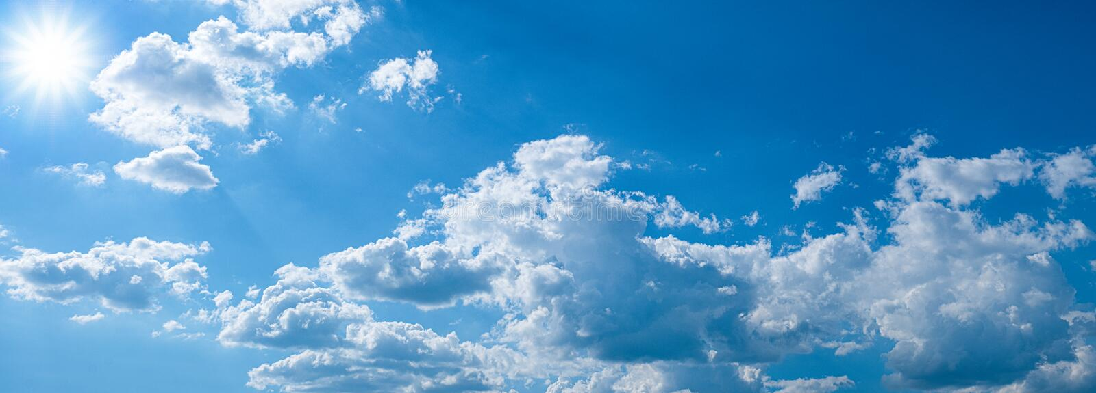Beautiful blue sky with white clouds and sunlight. Background abstract panorama stock photography