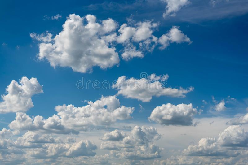 Beautiful blue sky with white clouds and a thin horizon line. Rays The sun breaks through the clouds. Space bright summer day outdoors light freedom heaven stock photos
