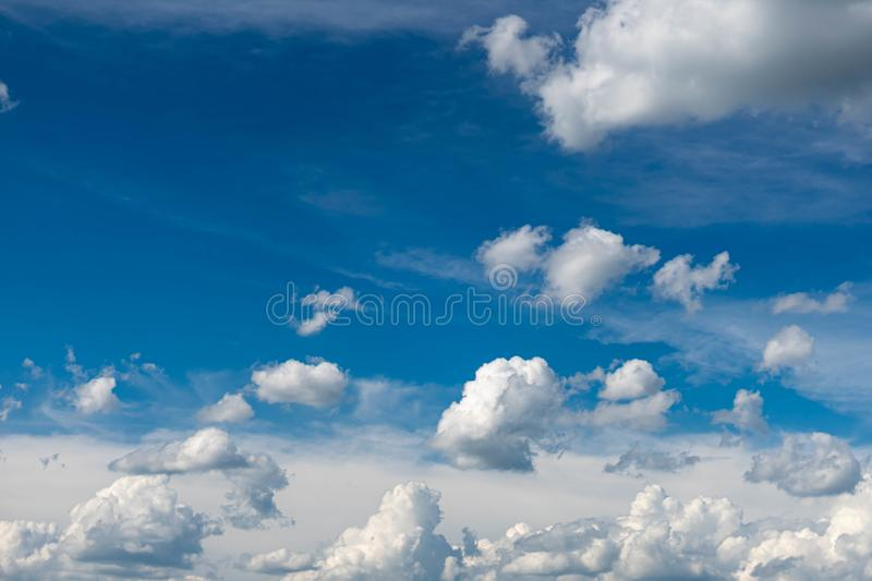 Beautiful blue sky with white clouds and a thin horizon line. Rays The sun breaks through the clouds. Space bright summer day outdoors light freedom heaven royalty free stock images