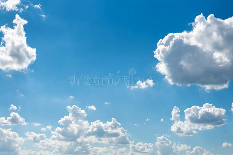 Beautiful blue sky with white clouds and a thin horizon line. Rays The sun breaks through the clouds. Space bright summer day outdoors light freedom heaven royalty free stock photos