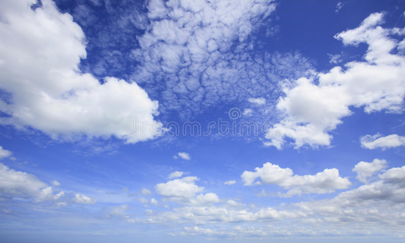 Beautiful blue sky and white clouds with wide angle camera lens. Use as nature background and free copy space backdrop stock photos